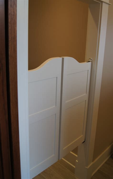 swinging closet doors for bedrooms saloon doors used as a door for a water closet great style