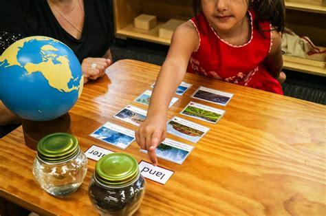montessori sandpaper globe with child - Montessori Academy