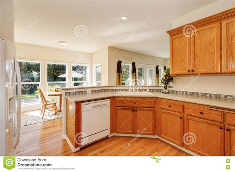 light brown kitchen cupboards light brown kitchen cabinets and white appliances stock 6970