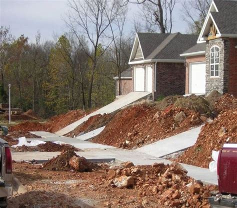 skip retaining wall for steep driveway or assume liability