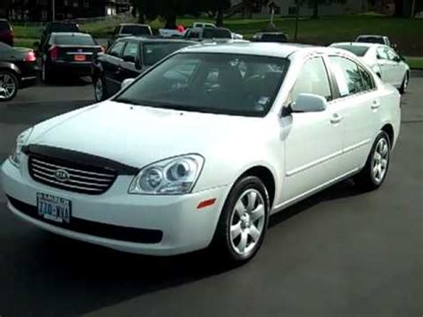 sold  kia optima lx white cloth interior enumclaw