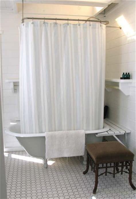 claw foot tub with shelves around katy elliott