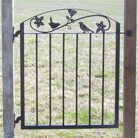 metal iron garden gate with birds and flowers