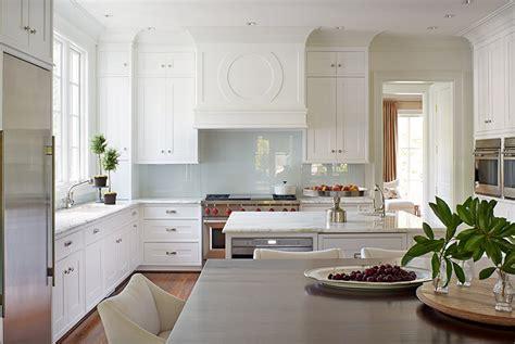White Kitchen With Glossy Blue Backsplash