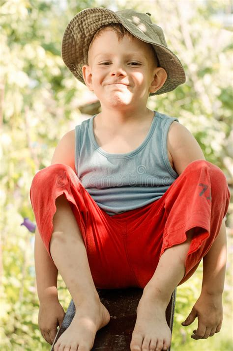 cheeky young barefoot country boy stock image image