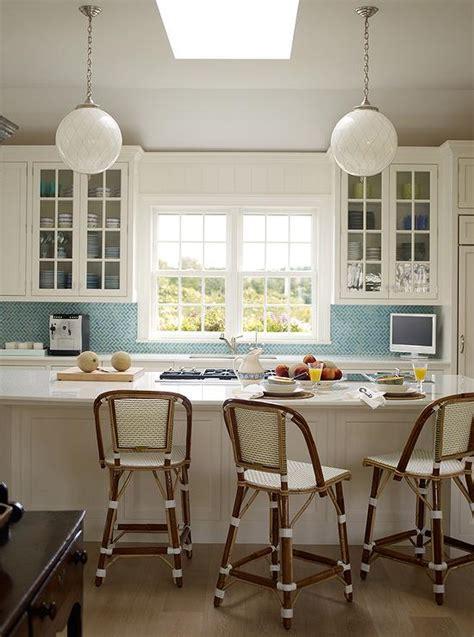 white kitchen  blue herringbone backsplash tiles