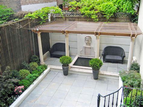 townhouse backyard nyc townhouse garden backyard patio bluestone fountain pergola shade plant traditional