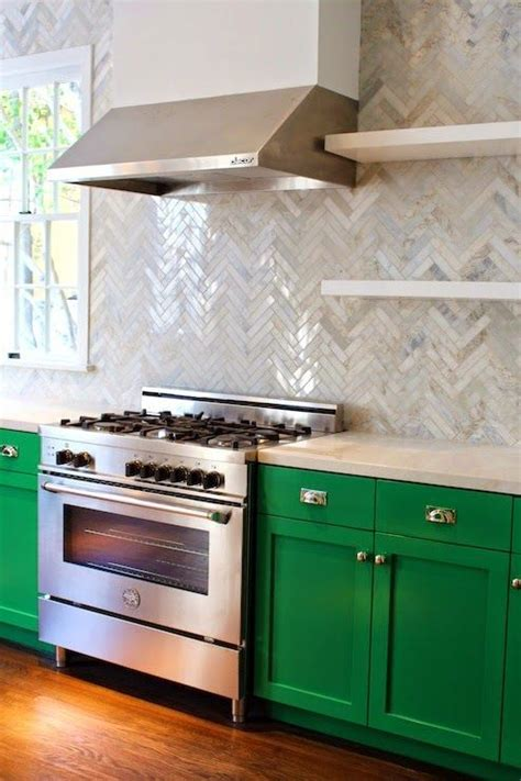 Lovely Kelly Green kitchen with Herringbone backsplash