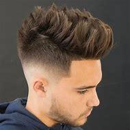 Medium Fade Haircut with Spiky Hair