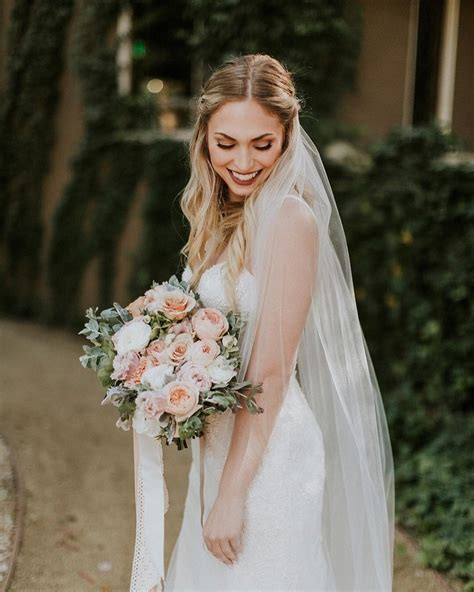 hair wedding styles with veil waves with middle part side twists and veil 1352