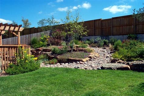 Landscaping Ideas For Small Sloping Backyards by Chic Landscape Ideas For Hillside Backyard Sloped Backyard
