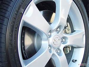 Image  2005 Mazda Mazda3 5dr Wagon S Manual Wheel Cap
