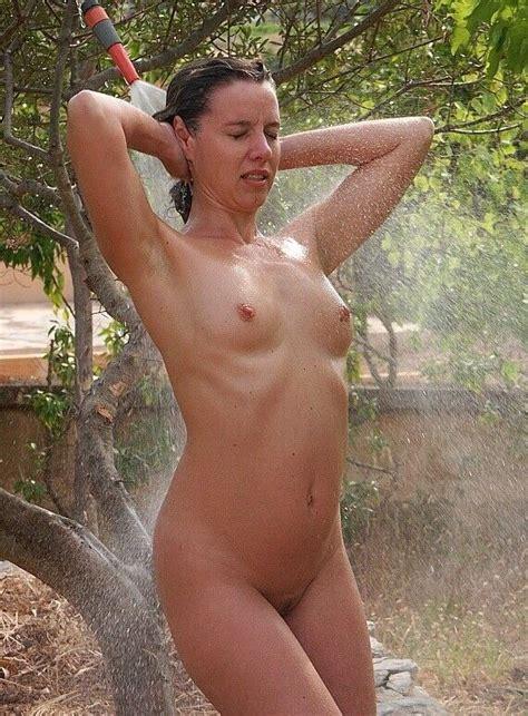 Voyeuy  Milfs Showering Outdoors