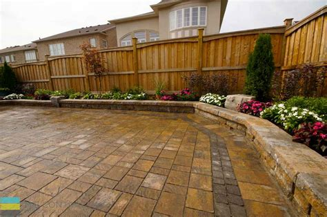 patio fences and walls 2 level interlock patio with retaining walls and large