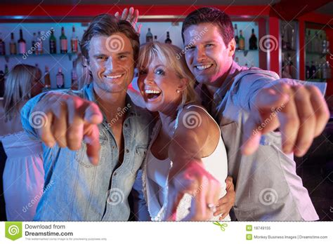 Senior Woman Having Fun In Bar With Two Young Men Stock
