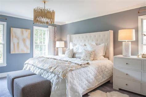 restful white  blue bedroom boasts slate blue walls