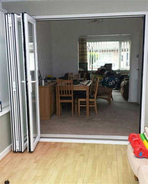 bifolding doors installed leading  house
