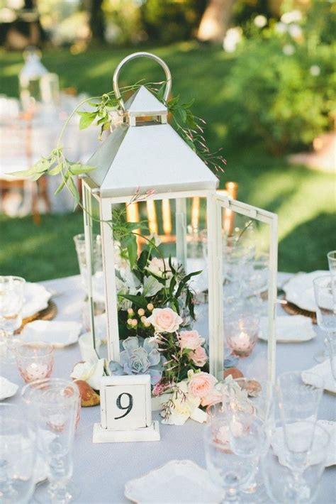 25 best ideas about lantern wedding centerpieces on wedding lanterns lantern table