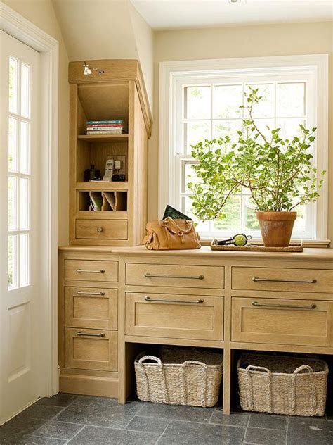 Country Mudroom with Light Wood Cabinets   Country