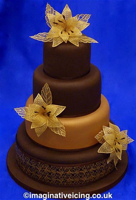 chocolate wedding cake  gold lace flowers