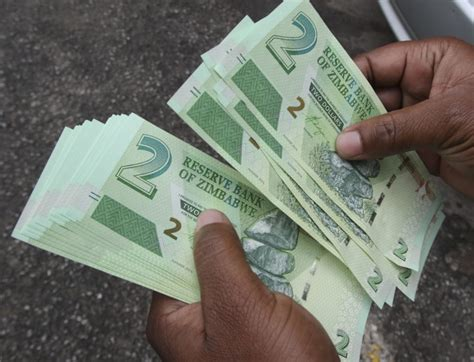 zimbabwe introduces  currency rtgs dollars