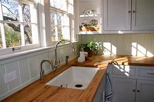 Beige reclaimed oak wood countertops for white l shaped for Kitchen wood cabinets white countertops