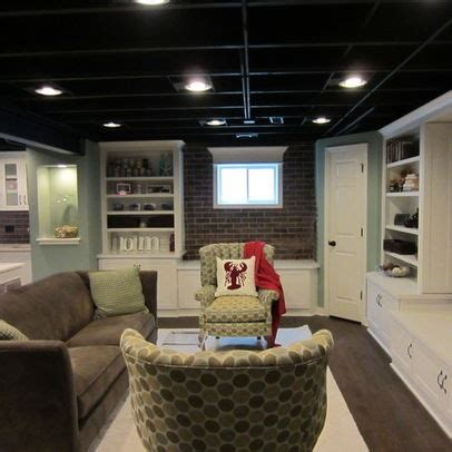 Exposed Basement Ceiling Ideas by Exposed Ceiling Painted Black Studio Ideas