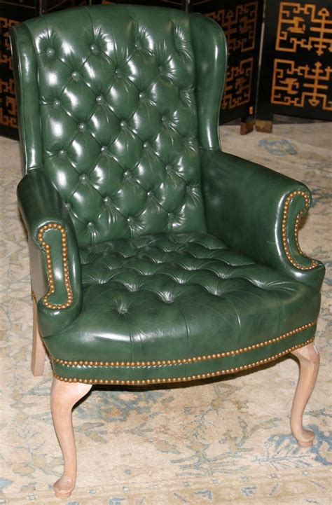 021418 green leather wingback chair lot 21418