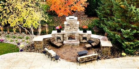 Backyard Paradise Landscaping by Poolside Fireplace From Balcony Traditional Patio