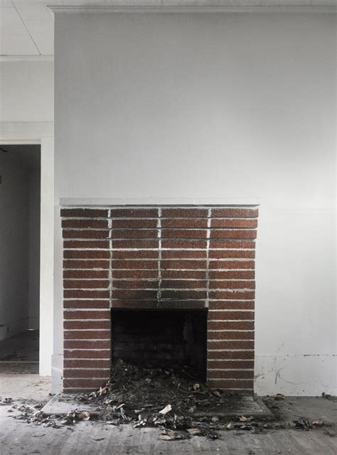 fireplace makeover painting  brick fireplace white