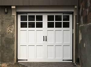 Carriage style garage doors carroll garage doors for Carriage type garage doors