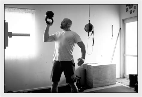 garage gym kettlebell rotator cuff stability mobility thoracic strength bottom press core