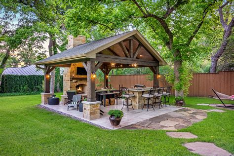 this freestanding covered patio with an outdoor kitchen
