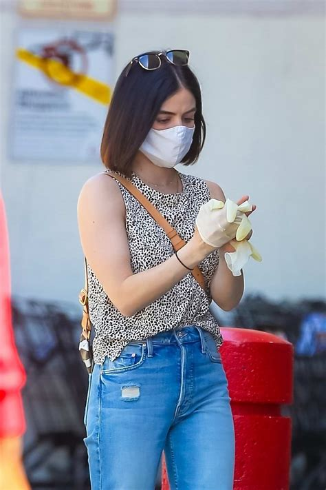 lucy hale puts on a mask and disposable latex gloves ...