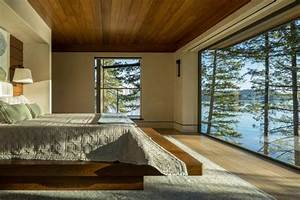 Lakefront Cliff House Design With Rocks Integrated Into