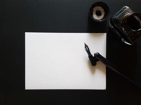 Sheet Of Paper, Pen And Ink Of Black On Black Office Desk