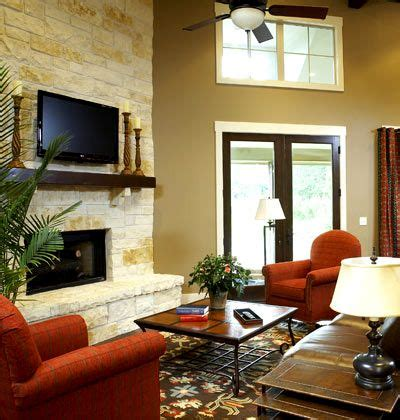 floor  ceiling stacked limestone fireplace