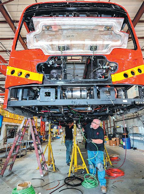 Workers Install Wiring In An Electric Bus At A Byd Factory