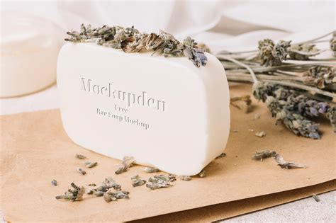 Impress your clients easily by using this free soap bar mockup in which you can personalize the craft soap, shopping bag and the wrapping paper to give your design a realistic look. Rectangular Bar Soap Mockup - Free Download