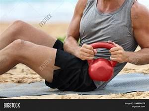 Fitness Man Lifting Kettlebell Image & Photo   Bigstock