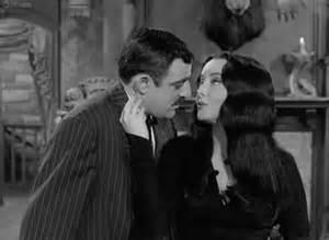 Morticia and Gomez Addams Kissing