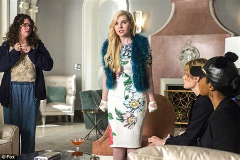 Scream Queens' Abigail Breslin wears fur coat while ...