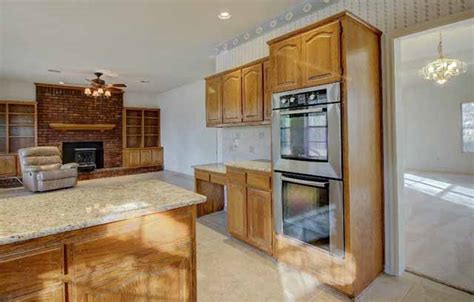 stately home on 1 acre in broken arrow