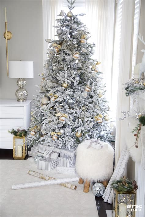 silver gold flocked christmas tree decorations setting