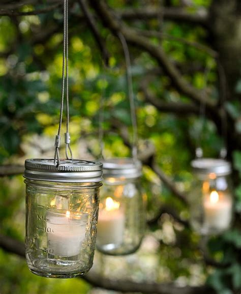 fill jars with tiny candles and then hang them on trees how to display candles at home