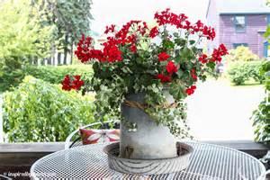 Wagon Wheel Garden Bench by A Roundup Of Creative Garden Containers