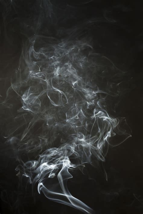 Black Background With Smoke Black Background With Dynamic Smoke Silhouette Photo