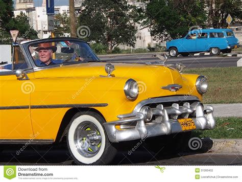 Classic Yellow Car With White Wall Tires In Havana