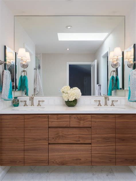 white transitional bathroom with custom floating walnut