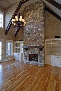 beautiful floor to ceiling fireplace with farmhouse